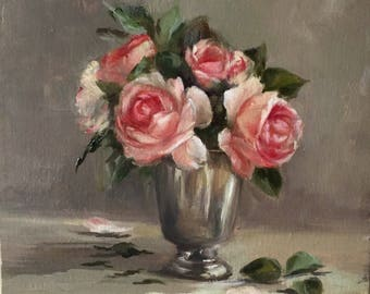 Bouquet of roses in a cup