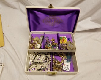 White Jewelry box with jewelry and costume jewelry. with key