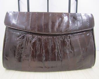 Rich chocolate brown eel skin clutch bag