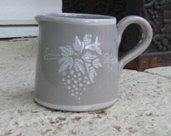 Creamer-jar has milk, grey enamel decor cluster in white