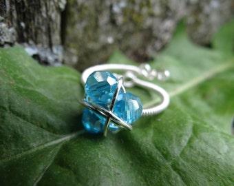 The L.O.Z.® Magical Zora's Sapphire Twist Ring in Beautiful Silver