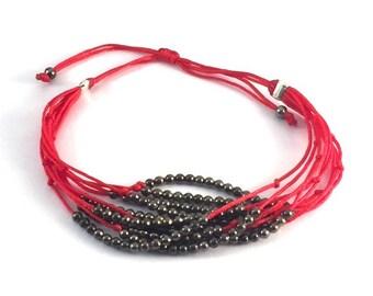 Red multi strand bracelet