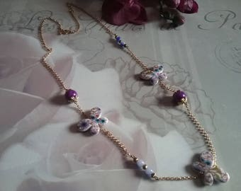 Butterflies with flowers and pearls necklace