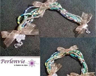 Bracelet multi strand seed beads and fabric bow
