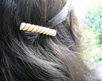 Late 80s French Barrette in early plastic ivory color. The grooves are accented by two braided brass strands; handmade . Single Specimen