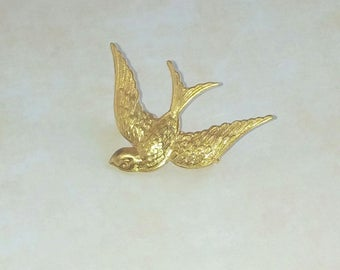 Brooch with golden brass swallow