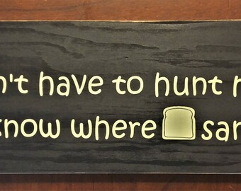 I'm glad I dont have to hunt my own food I don't even know where sandwiches live wooden sign