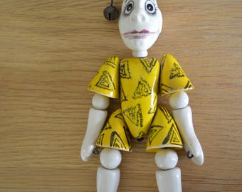 Clown in yellow, glazed ceramics, metal. Unhappy and frightening.