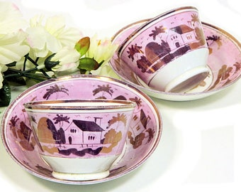 A Pair of Antique Early 19th Century Hand Painted Staffordshire Pink Luster Handleless Cups and Saucers Houses