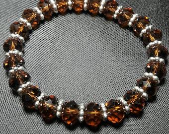 Elegant root beer brown crystal bracelet with silver accents. **Sale**