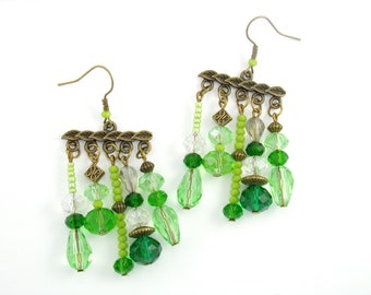Earrings bronze chandelier and glass beads transparent green metal
