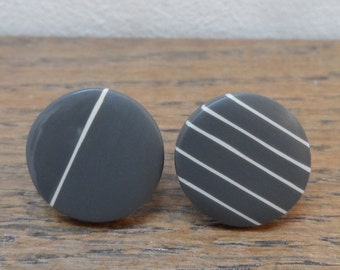 Charcoal + nude stripy 'don't match studs'