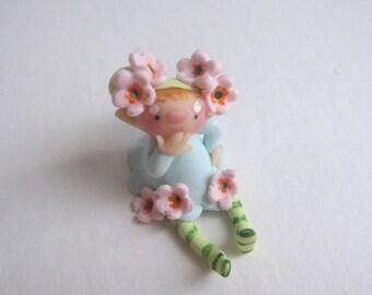 Tiny flower fairy figurine doll