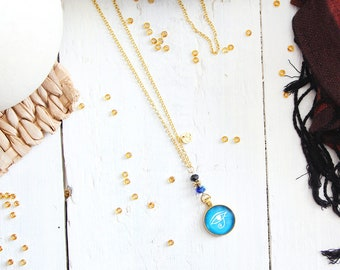 Necklace Oudjat, golden chain, golden base 20mm pendant, black, blue and gold beads, ancient egypt inspiration, for women