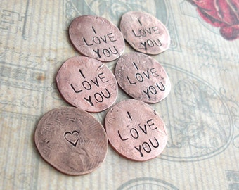 Penny Charm for your Pocket .. Includes 4 words. a touch piece .. hammered pennies with custom phrase, date or name stamped .. I LOVE YOU