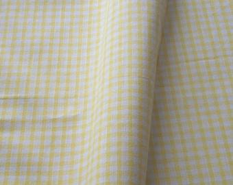 "a beautiful cut of cotton fabric ""yellow gingham"""
