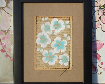 China... recycled book art Bahama Blue & Crisp White Blossoms painted on an Antique 1930s Encyclopedia book page Stitched to cardstock