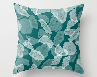 Decorative throw pillow with teal foliage design, indoor outdoor soft furnishing cushion for the living room or patio