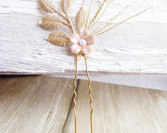 Peak bun bridal flowers, pearls and rose quartz