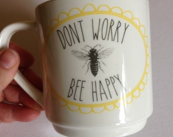 China mug featuring bees Don't worry Bee happy in perfect condition