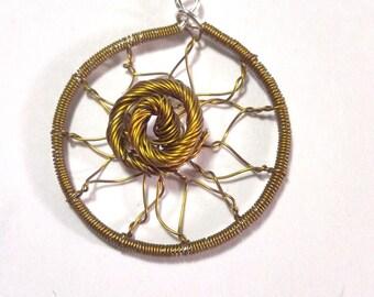 Golden pendant catch dreams
