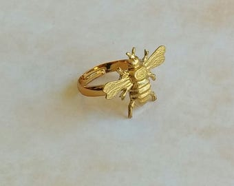 Adjustable ring with a raw brass bee