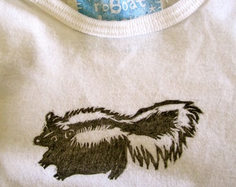 little skunk baby onesie