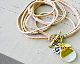 TAN SUEDE LEATHER Wrap Bracelet Mother of Pearl Charm Gold Leaf and Silver Flower Charms Gold Toggle