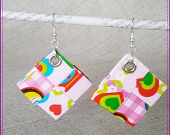 Earrings multicolored ears on a pink background