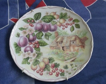 Kitchen plate painting with fruit and cottage