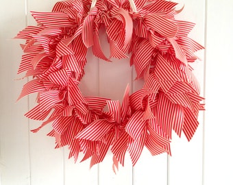 Red and white ribbon wreath