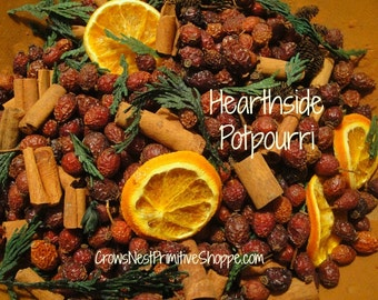 Hearthside Potpourri blended with rosehips, berries, spices, cinnamon, greens, cedar, organic sliced oranges, scented your choice fragrance