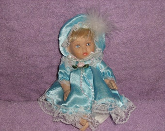 Porcelain Vintage String Baby Doll with Aqua Satin Dress