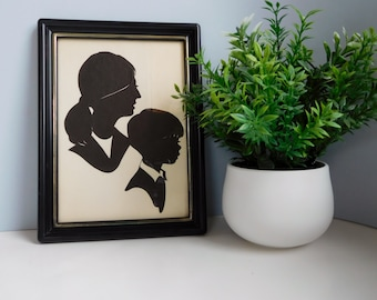 Vintage Wallie Spatz silhouette picture Signed boy and girl paper silhouette of woman