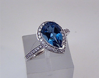 AAAA London Blue Topaz   1.40 Carats   in 14K White gold Engagement ring .30cts of diamonds. 1612 MMMM