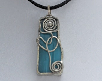 Charming Turquoise Stained Glass Pendant with Flower Motif