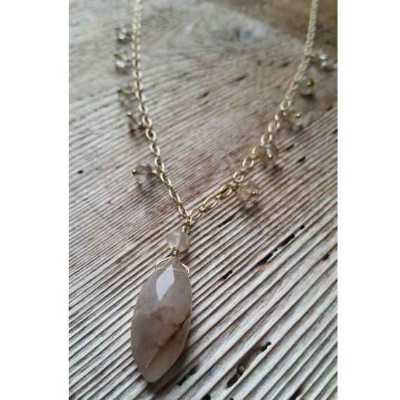 Golden rutilated quartz necklace on gold filled chain