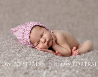 Cabled pixie bonnet baby hat with chin strap and button hand knit light dusky rose pink soft warm newborn girl photography photo prop