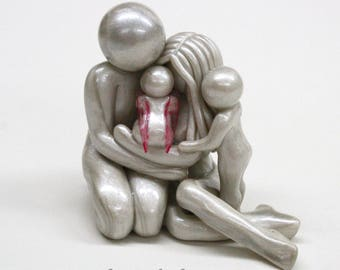 Bespoke Memorial Statue for family of 4 - Parents with earthside and heavenside child - clay sculpture - heartfelt keepsake - made to order