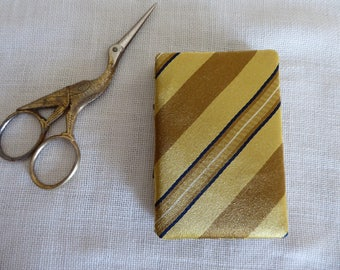 Gold black and bronze silk needle book
