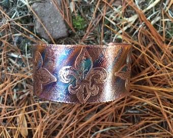 Fleur de Lis pattern etched on flame painted copper bracelet