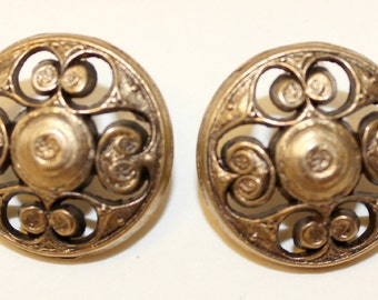 2 Vintage gold metal buttons with cut metal swirl design.