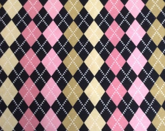 48 inches of Flannel/Black, pink, yellow and gold argyle print cotton fabric