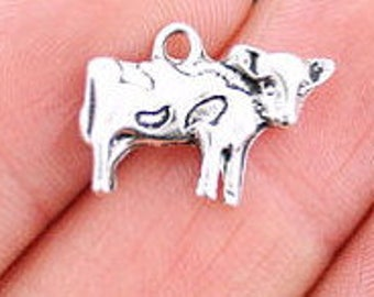 Silver tone cow charms
