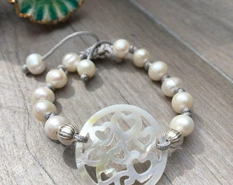 Adjustable length bracelet. Fresh water pearls and mother of pearl.