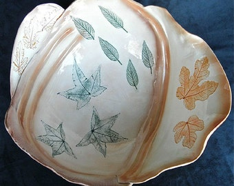 Large Autumn colored ceramic bowl with real Fig and Maple leaf imprints.