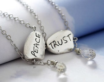 peace in trust double-sided necklace. inscribed pendant with Swarovski silver shade briolette