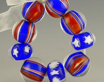 handmade lampwork glass bead set of 9 rounds and rondelles in red white and blue with stars and stripes - Patriot Days