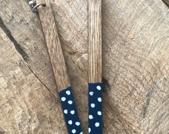 Long wooden earrings with black and white polka dots