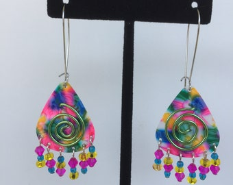 rainbow pick with spiral wire design finished with six strands glass beads on a kidney ear wire.